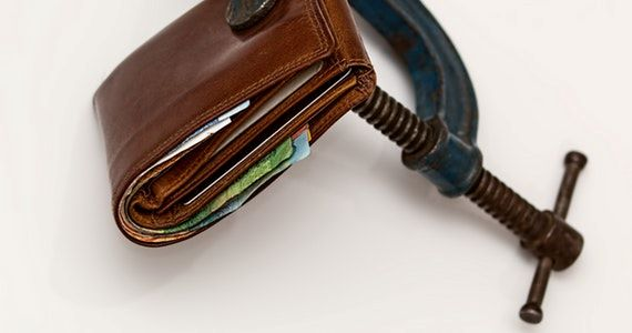 How to not grow your lifestyle business - image brown-leather-wallet-using-blue-steel-clap-46242 on https://www.deltafinancialgroup.com.au
