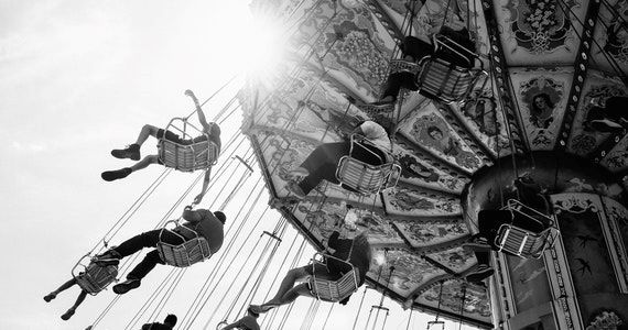 Look beyond the day to day - image people-riding-carnival-rides-2921542 on https://www.deltafinancialgroup.com.au