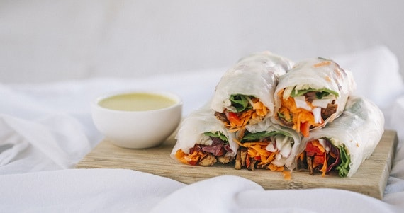 15 Healthy and Easy Snacks When You're Working From Home - image tempeh-satay-sticks-rice-paper-rolls on https://www.deltafinancialgroup.com.au