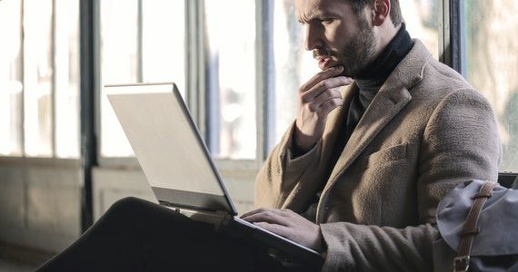 When can I afford to retire? How long will my money last? - image man-wearing-brown-jacket-and-using-grey-laptop-874242 on https://www.deltafinancialgroup.com.au