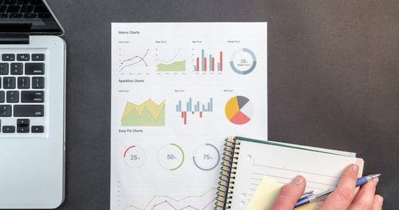 How to construct an effective portfolio - image person-holding-blue-ballpoint-pen-on-white-notebook-669610 on https://www.deltafinancialgroup.com.au