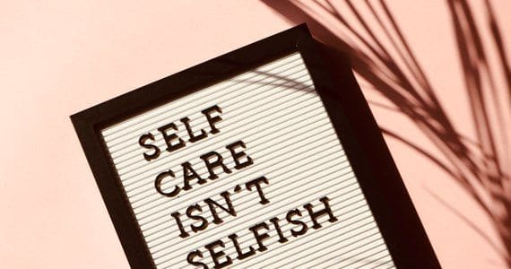 How to avoid burnout and find balance - image self-care-isn-t-selfish-signage-2821823 on https://www.deltafinancialgroup.com.au